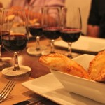 Wines for tasting, with tapas of beef-filled empanadas, at the Bocanariz wine bar.