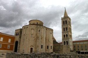 The ninth century St. Donat Church, built using stones from Zadar's ruined Roman Forum. The bell tower associated with the Zadar Cathedral is at right.