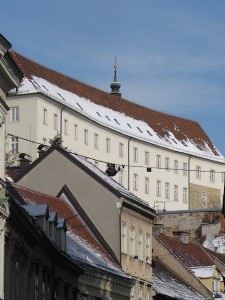 An Upper Town building at top, overlooking buildings in Zagreb's Lower Town.