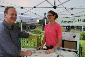 Dave Hunt, head chef at the Generations restaurant in Lake Placid's Golden Arrow Lakeside Resort, and Michelle Asselin, owner of Harmony Hills Farmstead, Malone, N.Y., seen at Lake Placid's weekly farmers' market.