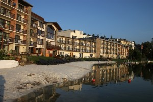 The Golden Arrow Lakeside Resort and its Mirror Lake beach in the town of Lake Placid.