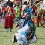 Crow man, in traditional regalia, dancing during the Crow Fair powwow.