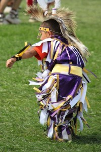 Young Crow boy dancing his heart out during the Crow Fair powwow in August 2013.