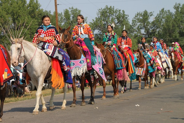 Women riding in the horse parade at the Crow Fair in August 2013.