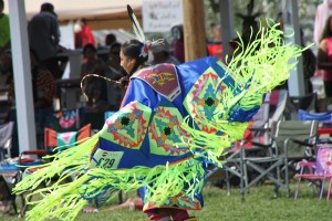 Dancers show off their shawls in the shawl dance that was part of the Crow Fair's powwow in August 2013.