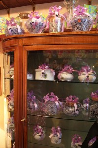 Wares offered for sale at La Violeta, a tiny Madrid shop where violets, the flowers, and violet, the color, provide the overriding theme for candies and other merchandise.