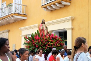A religious procession in the streets of Cartagena's Old Town.