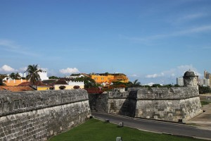 A section of Cartagena's nearly seven miles of city walls. The orange exterior of the Santa Teresa Hotel is visible at center rising above the walls.