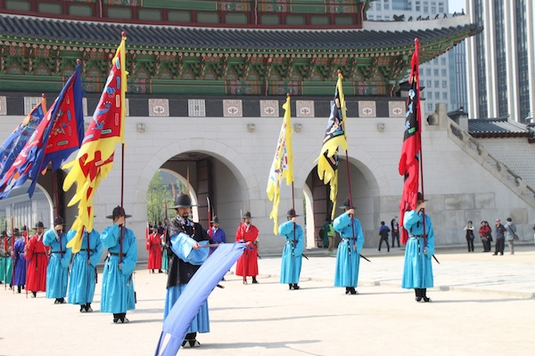 Costumed reenactors demonstrate the traditional changing-of-the-guard ceremony at Seoul's Gyeongbok Palace.