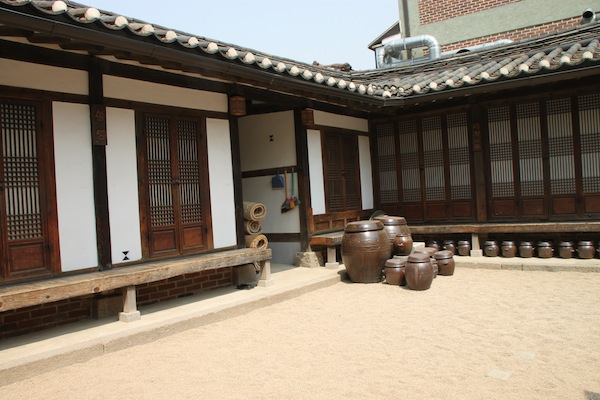 A courtyard in the model house that tourists visit in Seoul's Bukchon Hanok Village. The raised floor leaves room for under-floor heating.