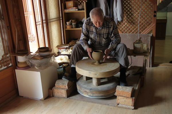 A potter demonstrating his skills at a workshop in Seoul's Bukchon Hanok Village.