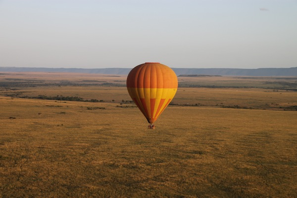 One of several balloons that shared the skies with our own. The view also highlights the majesty of the Maasai Mara landscape.