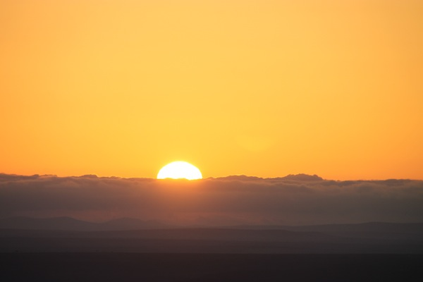 Sunrise on the Maasai Mara, seen from a hot-air balloon.