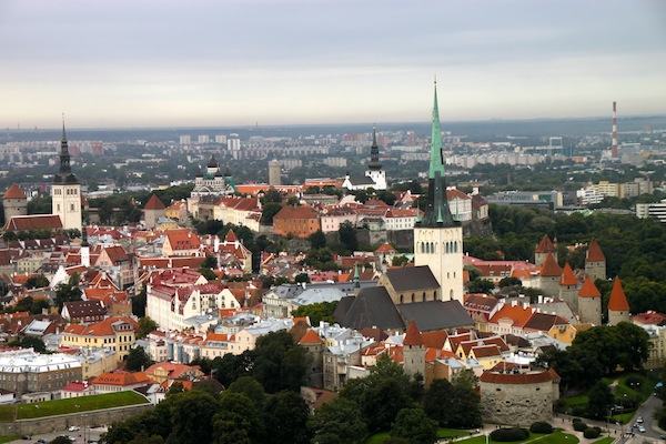 Tallinn's historic city center seen from a helium balloon, nearly 400 feet in the air. The tallest spire belongs to St. Olaf's Church. The Lower Town is in the foreground, with Toompea Hill in the back.