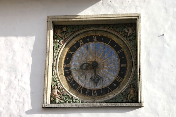 The painted wall clock on the exterior of Holy Spirit Church.
